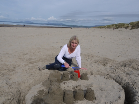making sandcastles on Harlech beach.